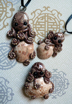 calico_clam_octopus_trio_by_blackmagdalena-d4f6nv7
