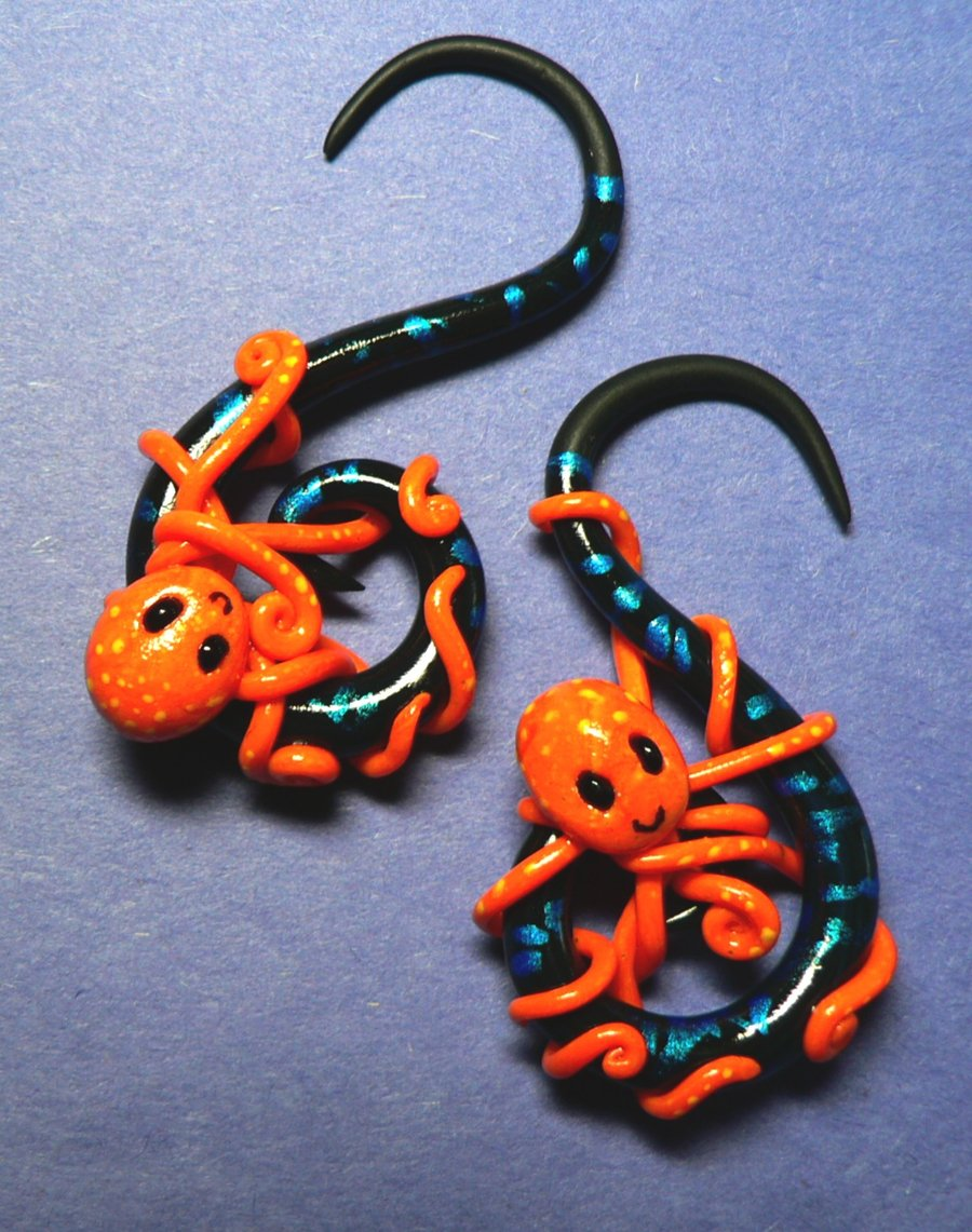 orange_octopus_ear_plugs_by_blackmagdalena-d2zxzth