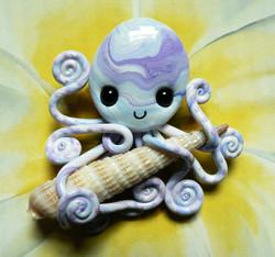 octopus_with_atlantic_auger_magnet_by_blackmagdalena-d4jrumz