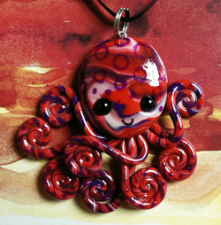 red_ringed_octopus_necklace_by_blackmagdalena-d4j3q9d