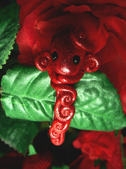 ruby_red_octopus_hair_clip_by_blackmagdalena