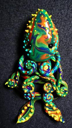 spikey_rainbow_squid_magnet_by_blackmagdalena-d4fbpec