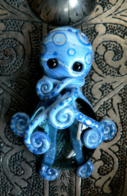blue_stone_octopus_magnet_by_blackmagdalena-d4f7g8h
