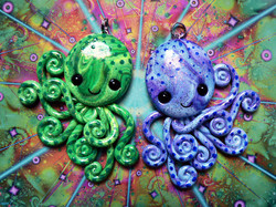 green_and_blue_twin_octopi_necklaces_by_blackmagdalena-d4o14xb