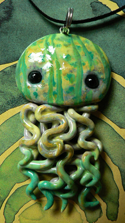 green_handpainted_jellyfish_necklace_by_blackmagdalena-d4j3r1l