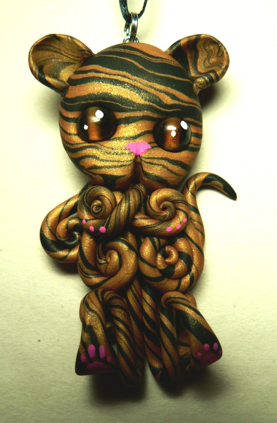 tiger_kitty_octopus_necklace_by_blackmagdalena