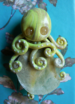 yellow_jingle_shell_octopus_magnet_by_blackmagdalena-d4f6is1