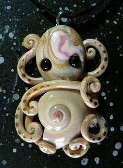 cats_eye_glittery_octopus_necklace_by_blackmagdalena-d4ezbf9