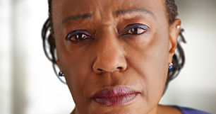 A close-up of a elderly black woman look