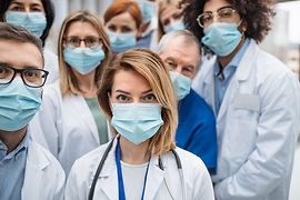 Group of doctors with face masks looking