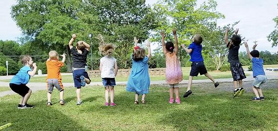 Preschool 4 Year Olds Jumping for Joy
