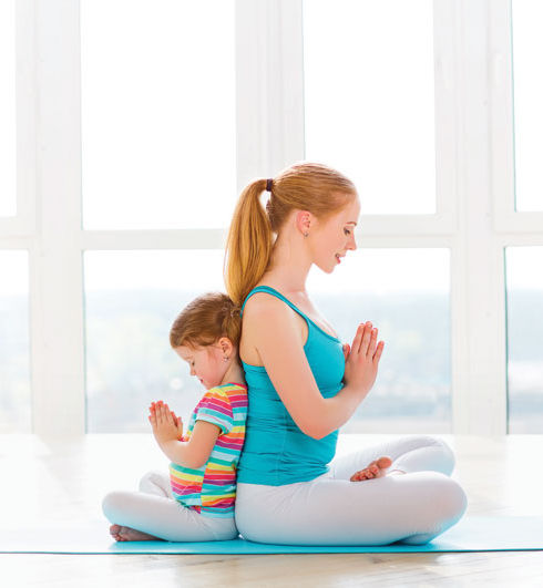 family-mother-and-child-daughter-are-engaged-in-meditation-and-y.jpg