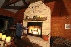 Fire in fireplace in the dog-trot