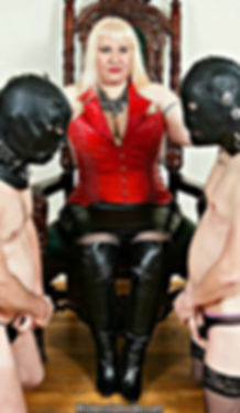 Mistress Eva Lordes on her Throne with two subs.