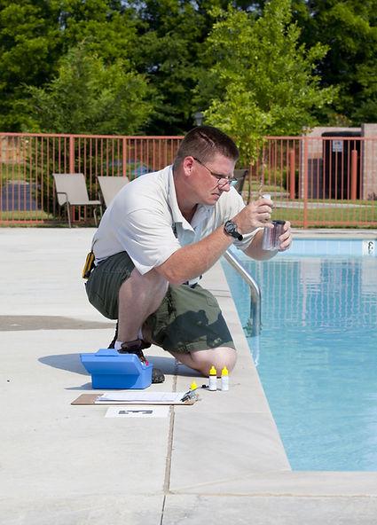 Service%20man%20checking%20chlorine%2C%2