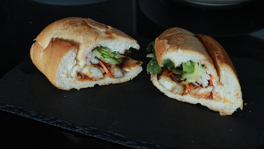 Homemade grilled lemongrass chicken bahn mi baguette sandwich