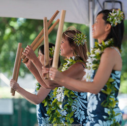 SunshineFromPolynesia-hula-dancers-with-bamboo-implements