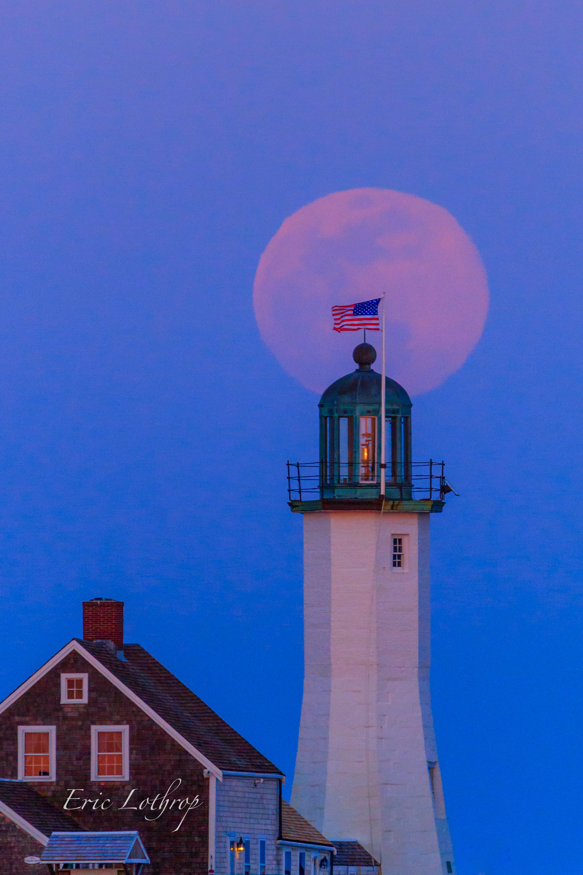 Super worm moon rising over Old Scituate Light.
