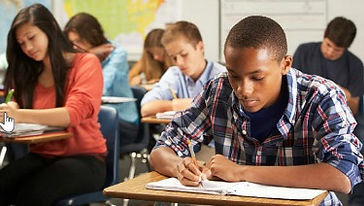 teens_doing_schoolwork_classroom.jpg