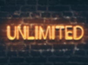 Unlimited neon sign on dark brick wall b