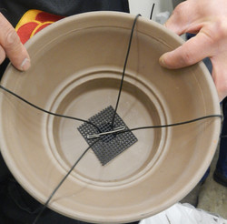 Tie-down wires for one-hole pot