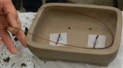 Measuring tie-down wires for