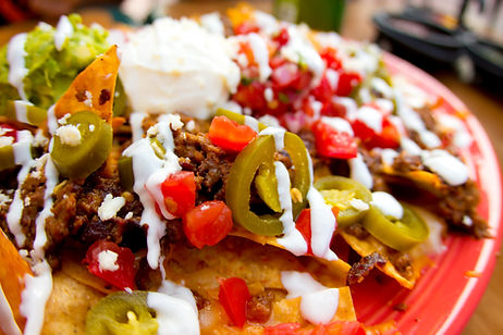 Mexican appetizer of nacho chips loaded