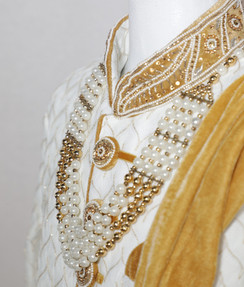 White Sherwani with embroidered neckline, scarf and pearl necklace