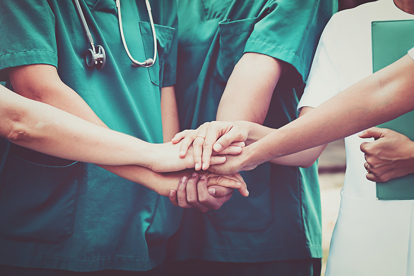 Group of Doctors and nurses coordinate h