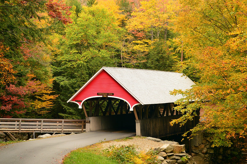 A True New England Scene: a Covered Bridge Surrounded by Fall Foliage in the Franconia Not