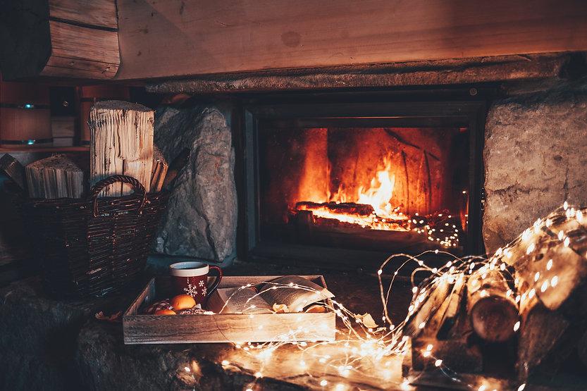 Warm cozy fireplace with real wood burni