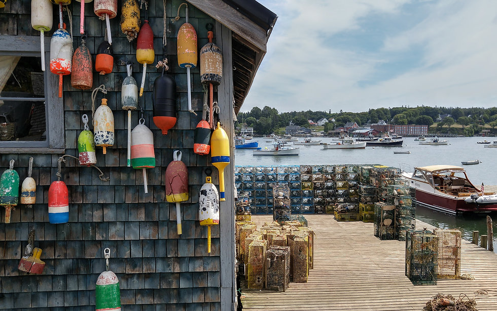 New England Lobster Fishing Dock:  Marker buoys for lobster traps decorate the side of a f
