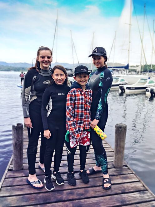 Kids on a jetty getting ready to wakeboard and wakesurf