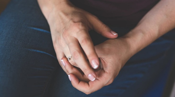 four habits that will kill your new marriage woman removing wedding ring The Divine Reflection