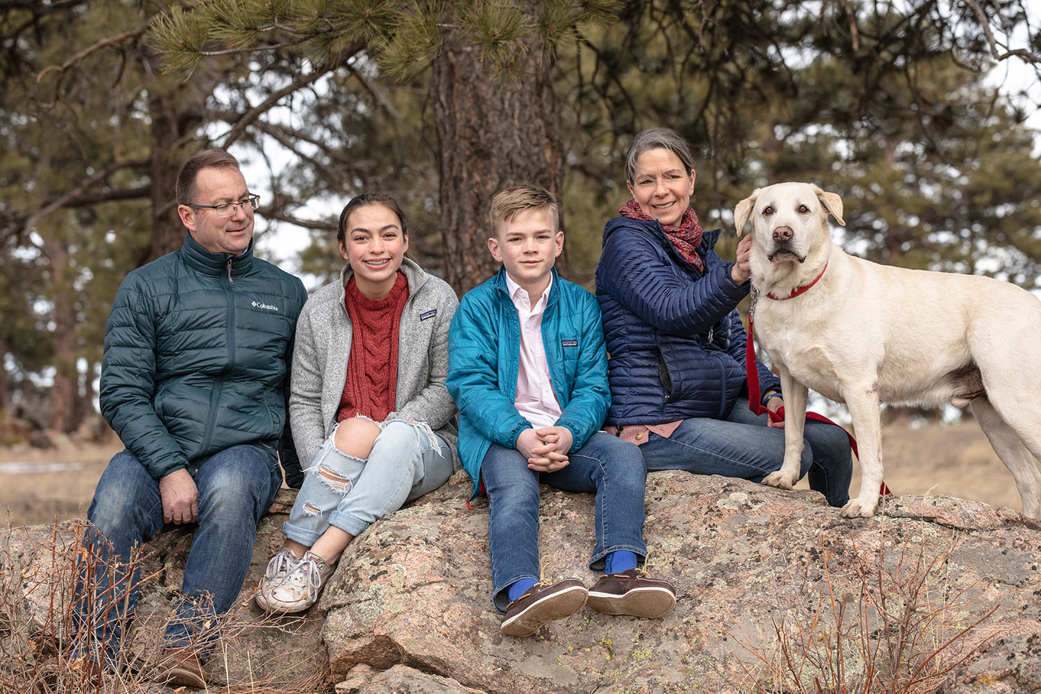 Dog and family portrait in the mountains
