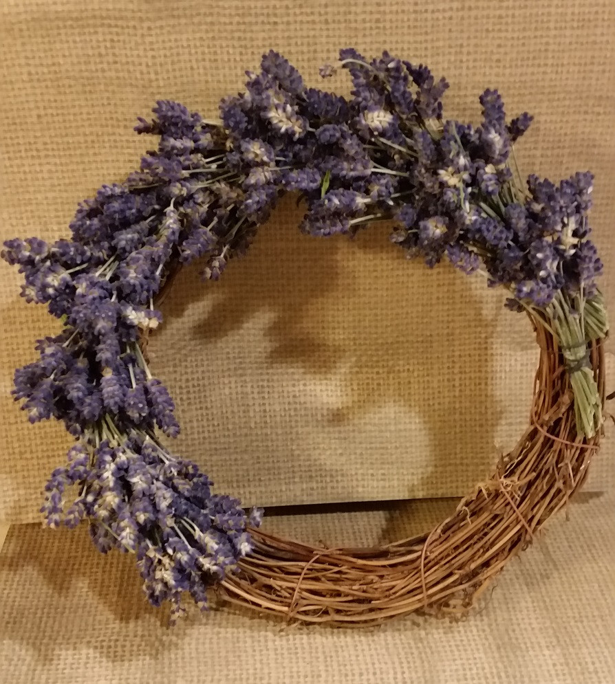 This natural wreath is now half covered with smaller bound lavender bunches.