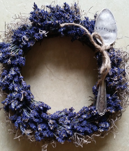 Flattened spoon, imprinted with lavender and tied to a lavender wreath with moss and a natural wreath frame.