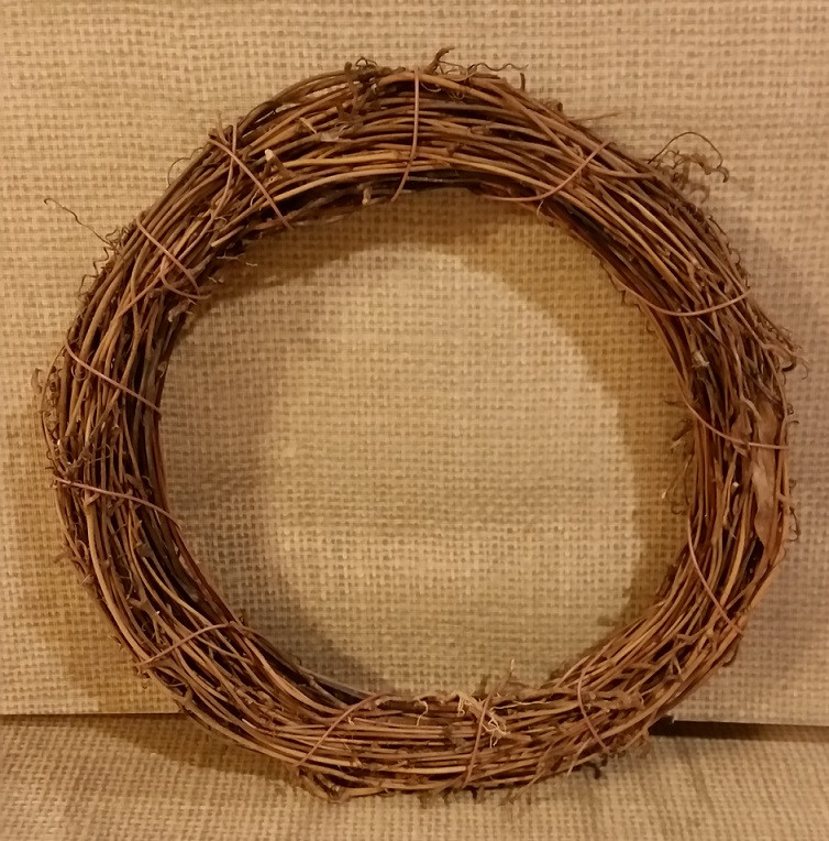 Wreath frame made of branches commonly found at craft supply stores.