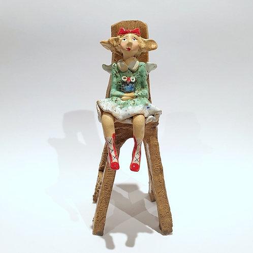 Na krzesełku z sówką
