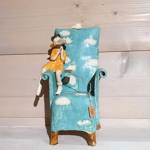 Marzyciel na fotelu