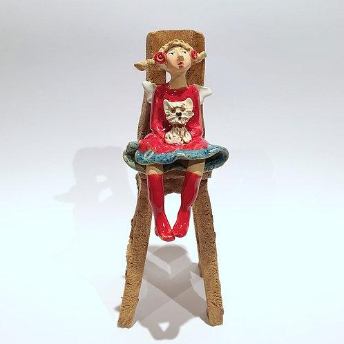 Na krzesełku z pieskiem
