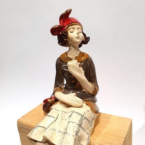 Dama z torebką przy kawce