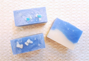 Christmas Blue art soaps handcrafted with flower confetti and layering technique