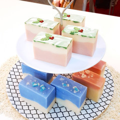 A collection of 3D art soaps on a cake tower stand
