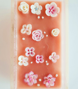 Student's 3D art soaps decorated with flower confetti before cutting