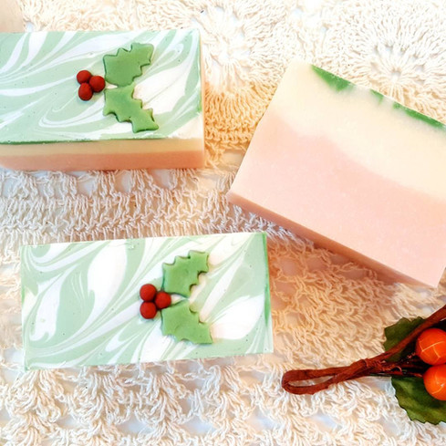 Christmas Green art soaps with 3D mistletoe leaves confetti on the top and a thin layer of green leafy swirl