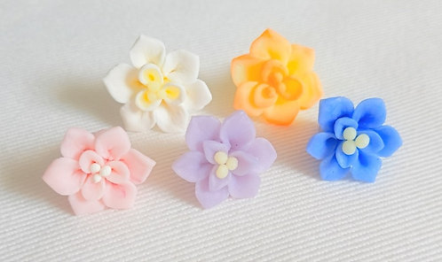 Elegant and intricate lotus flower confetti made from cold process soap clay for 3D soap art design