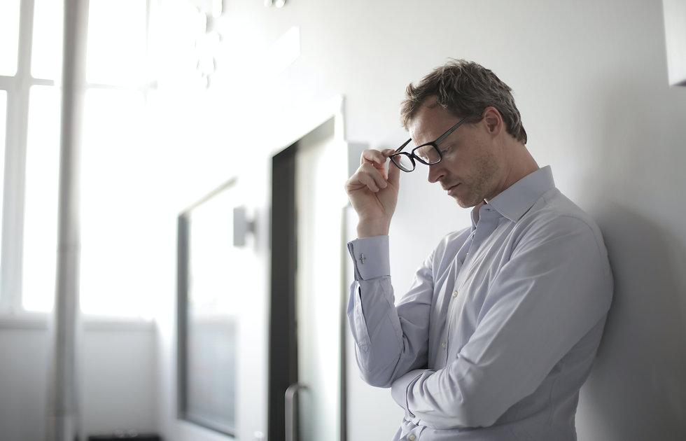 photo-of-man-holding-black-eyeglasses-37