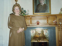Mrs Taylor at home with her portrait