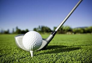 golf-ball-on-tee-and-golf-club-on-golf-c